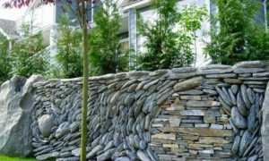 Забор частокол – старинное ограждение в современных ландшафтных дизайнах