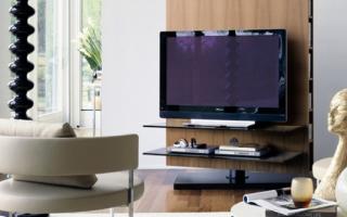Как правильно можно вписать телевизор в интерьер вашей гостиной